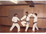 Instructor Mike Masley And His Students